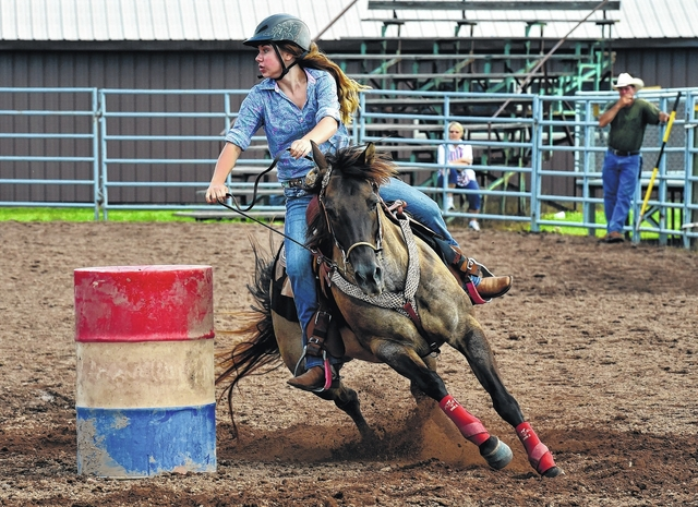 7eecac765aa Madison Poust competes in the barrel racing during the Keystone Junior Rodeo  Association jackpot contest Sunday