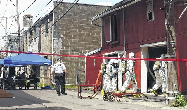 Law Enforcement Officials In Hazardous Materials Suits Enter A Garage At  217 E. Spruce Alley In Hazleton On Tuesday To Remove Barrels Of Toxic  Chemicals ...