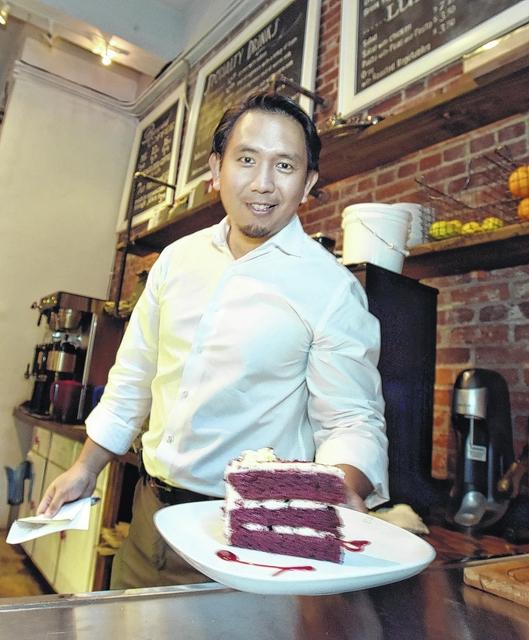 Robert Paulino of Adezzo Coffee Shop & Lounge in center city Scranton with a dessert.