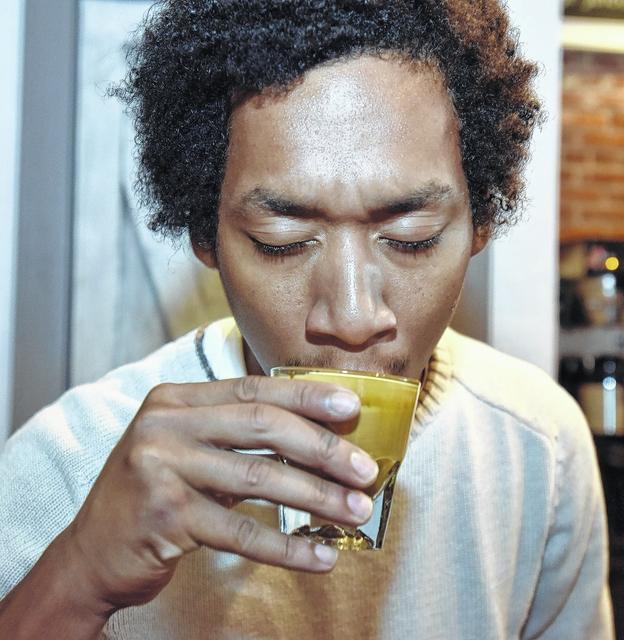 Adezzo Coffee Shop & Lounge barista Sean Cuthkelvin drinks an espresso.