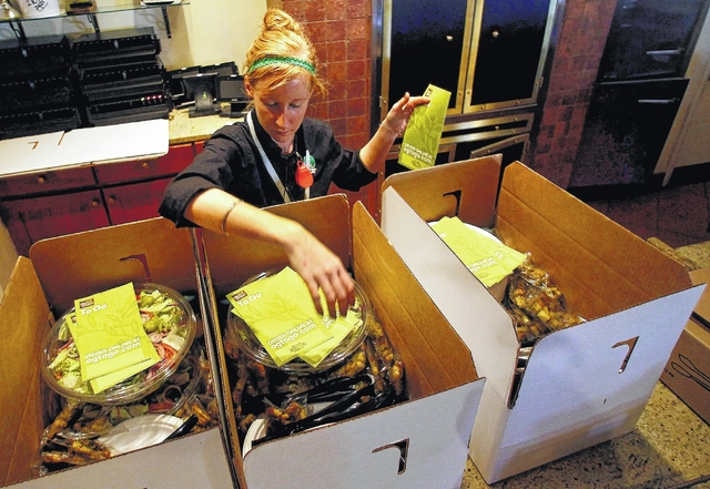 ciara gregory an olive garden employee fills boxes with food for first responders monday at the wilkes barre township restaurant - Olive Garden State College