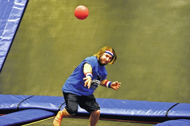 James Colarusso, of Mericle Commercial Real Estate, hurls the ball at the Air Force team in a dodgeball tournament at Sky Zone Trampoline Park in Jenkins Township on Monday. The tournament was a partnership between Mericle Commercial Real Estate and members of the U.S. Armed Forces to benefit the Marine Corps' 'Toys for Tots' campaign.