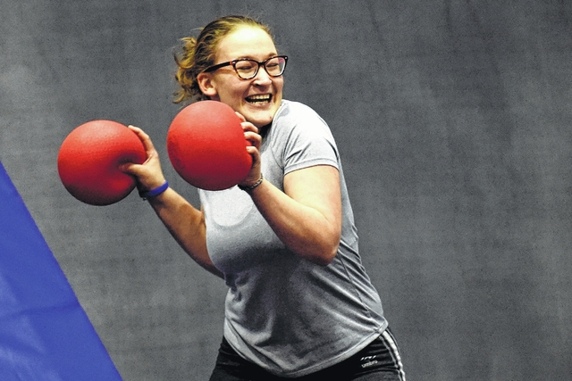 Olivia Kirk, of Jacobi Capital Management, braces herself for a ball being thrown by members of the U.S. Marine Corps Reserve in a dodgeball tournament at Sky Zone Trampoline Park in Jenkins Township on Monday.