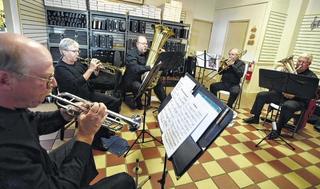 From left, Barrie Bartle, of Hamlin, Mary Ann Yonchiu,k of Tunkhannock, Raymond Stedenfeld, of Gouldsboro, Cliff Girard, of Clarks Summit and Wayne Smith, of Elmhurst, of the Brass Reflections group rehearse holiday music.