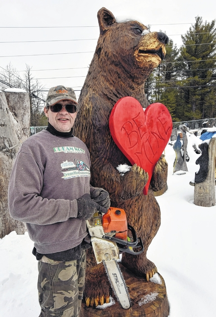 Chainsaw wood carver michael blaine turns hobby into