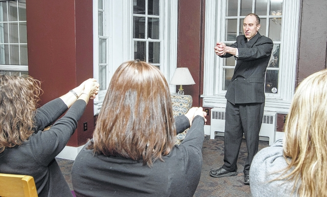 Hypnotist, Chris Halbohm, leads his audience through an exercise at the Hoyt Library in Kingston.
