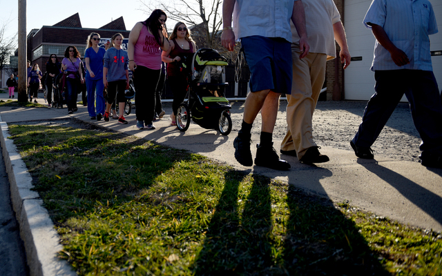 Friends and family of Laurie Merritt walk on N. Pennsylvania Ave. in Wilkes-Barre in her honor on Friday afternoon. 4/15/16. Sean McKeag | Times Leader