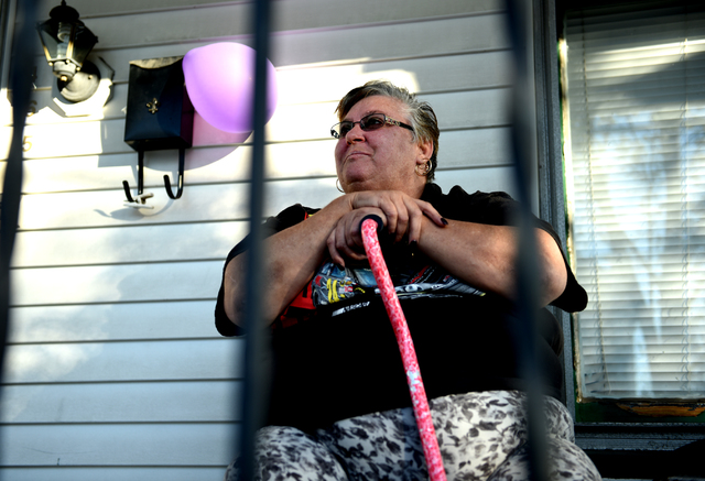 Barbara Vega displayed a purple balloon from her mailbox Friday night and watched friends and family of her former mail carrier, Laurie Merritt, walk by on North Pennsylvania Avenue in Wilkes-Barre to commemorate the second anniversary of Merritt's death in a fire intentionally set at her home.