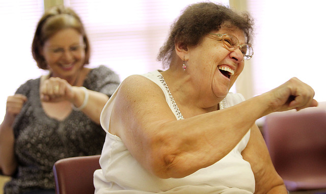Cookie Norton laughs during a boxing style exercise at the Edwardsville Senior Center.
