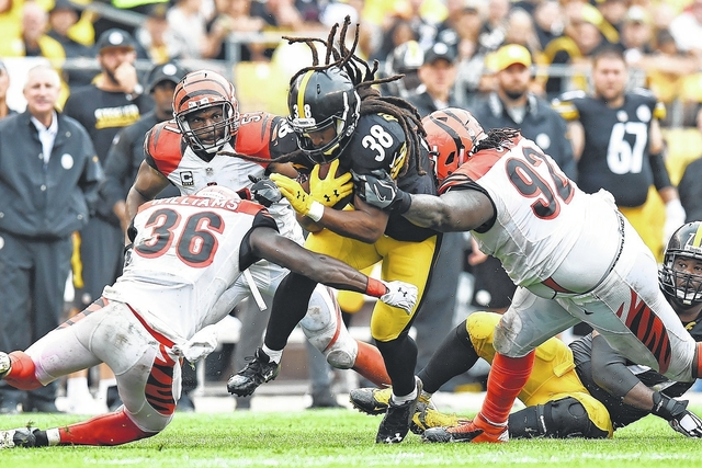 6e0f1a3dc Pittsburgh Steelers running back Daryl Richardson (38) is tackled by  Cincinnati Bengals strong safety