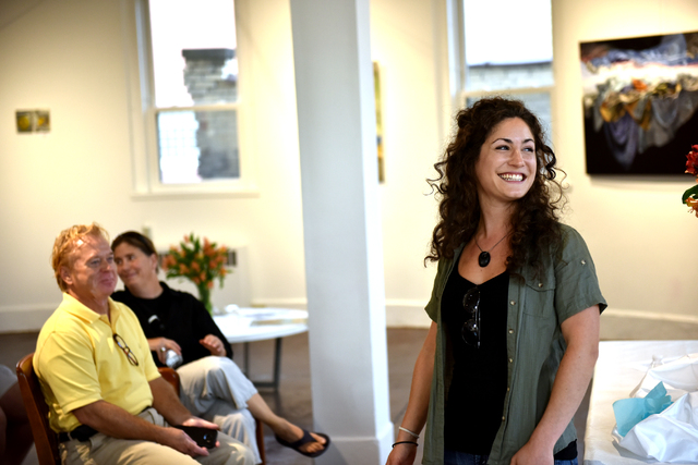 Artist Dana Kotler smiles as she explains her work during her lecture Aug. 30 at the Circle Center for the Arts in downtown Wilkes-Barre. Kotler's pieces are on exhibition until Sept. 30.