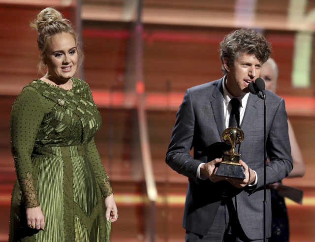 "Greg Kurstin, right, and Adele accept the award for song of the year for ""Hello"" at the 59th annual Grammy Awards on Sunday, Feb. 12, 2017, in Los Angeles. (Photo by Matt Sayles/Invision/AP)"