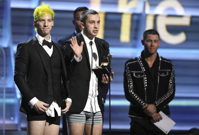 "Josh Dun, left, and Tyler Joseph of ""Twenty One Pilots"" appear onstage without pants to accept the award for best pop duo/group performance for ""Stressed Out"" at the 59th annual Grammy Awards on Sunday, Feb. 12, 2017, in Los Angeles. (Photo by Matt Sayles/Invision/AP)"