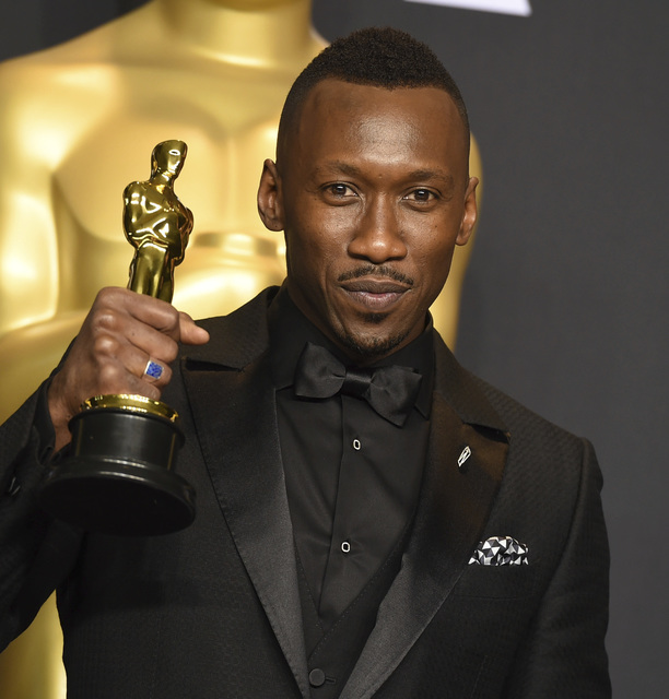 """Mahershala Ali poses in the press room with the award for best actor in a supporting role for """"Moonlight"""" at the Oscars on Sunday, Feb. 26, 2017, at the Dolby Theatre in Los Angeles. (Photo by Jordan Strauss/Invision/AP)"""