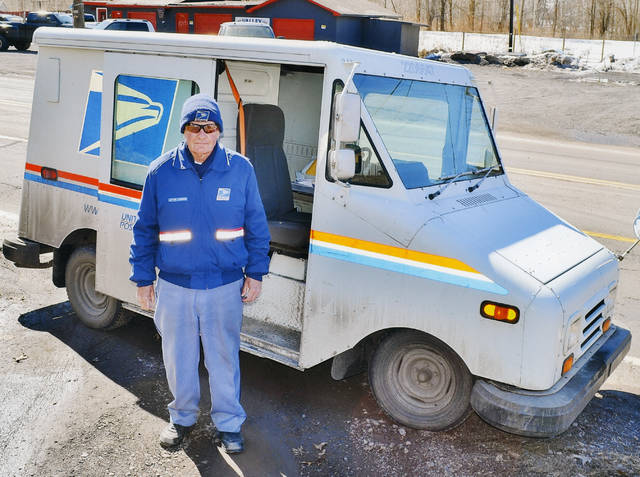 Joe Lloyd stands next to his mail truck in this undated photo. He delivered in West Nanticoke for the final 30 years of his life. (Courtesy photo)