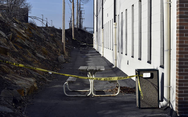 The rear of a building on Pennsylvania Avenue in Wilkes-Barre that houses Luzerne County Children and Youth offices is shown roped off as a crime scene after a reported fire bombing Monday.