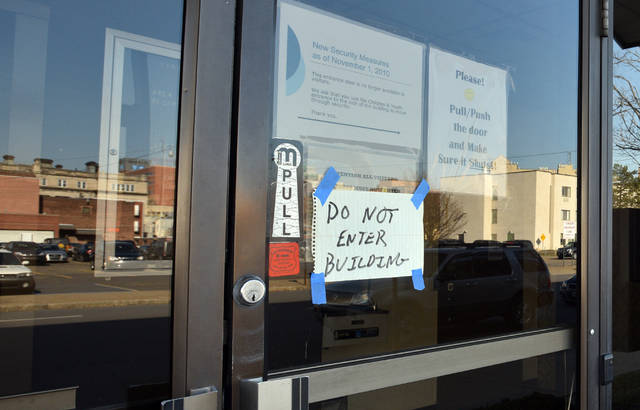Signs taped to the front door advise the building was closed Monday.