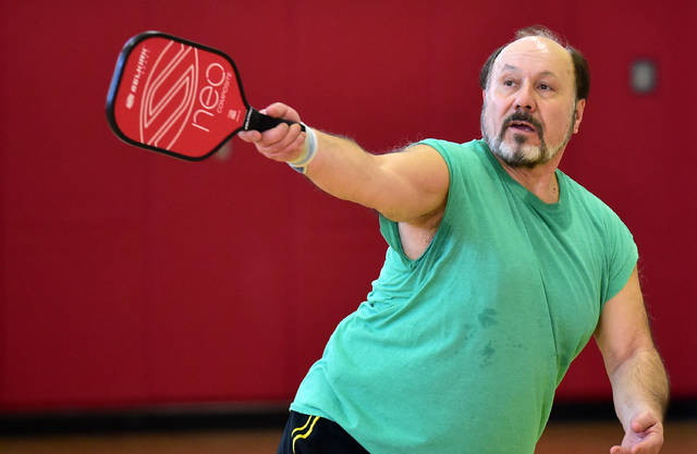 Chic Marra, of Hanover Township, plays a round of pickleball. Marra, an avid tennis and racquetball player, said he's picked up pickleball as a 'rehab game' and loves it.