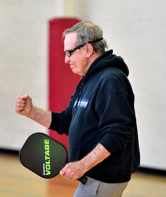 Bill Runner reacts after a missed opportunity during a doubles pickleball match. Runner said pickleball has no age limits and caters to the competitive nature of athletes and sports enthusiasts.