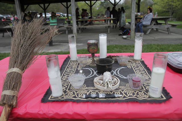 A ceremonial table set for the Beltane Festival represents the earth, wind, sea and sky. The candle in the middle represents the spiritual world.