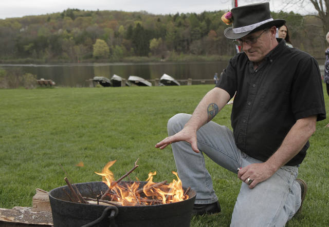 Shawn Harrington, of Noxen, starts the ceremonial Beltane fire during spring festivities at Frances Slocum State Park.