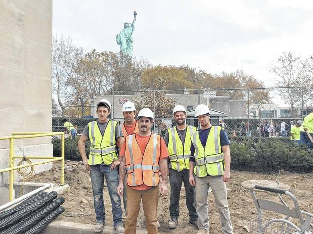A crew from Mid-Atlantic Waterproofing takes a break from working on an administrative office at the Statue of Liberty.