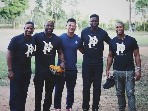 Scranton/Wilkes-Barre RailRiders outfielder Rob Refsnyder, center, is one of more than 40 professional baseball players who are helping raise money for the project Striking Out Poverty, which helps eliminate poverty in El Mirador, Domincan Republic. Submitted photo
