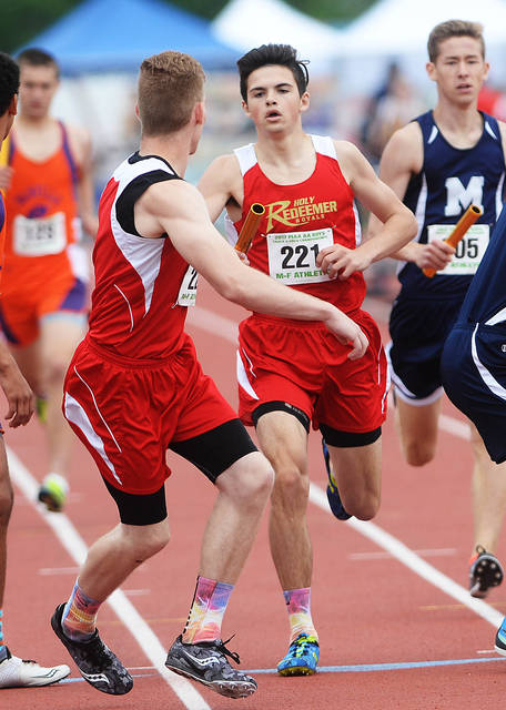 Holy Redeemer's Lukas Volpetti, right, hands off to Jonathan Weybrecht during a boys Class 2A 3,200 relay that brought the Royals a surprising fourth-place state medal Saturday.
