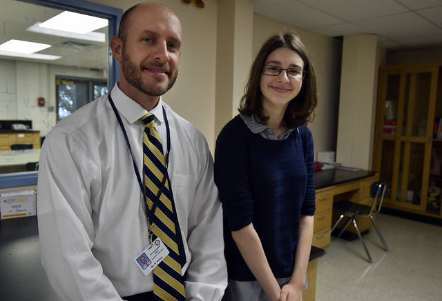 "English teacher Kevin Welles sits with Meghan Cook who won the Caffrey Welles Fine Arts Award at Meyers High School for her novella ""The Penny Man."""