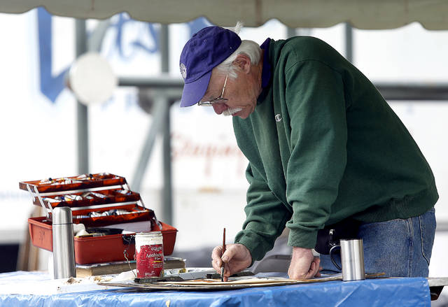 Tim Weaver, of Drums, works on a watercolor painting.