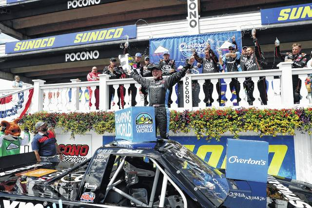 Christopher Bell celebrates after winning Saturday's Trucks Series race at Pocono Raceway in Long Pond, Pa.