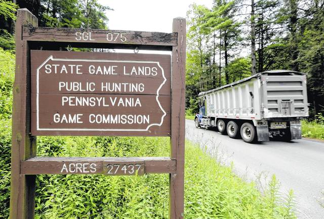 A dump truck heads for the Fisher Mining Company site on State Game Land 75 in Pine Township, Lycoming County. (Bill Tarutis | For Times Leader)