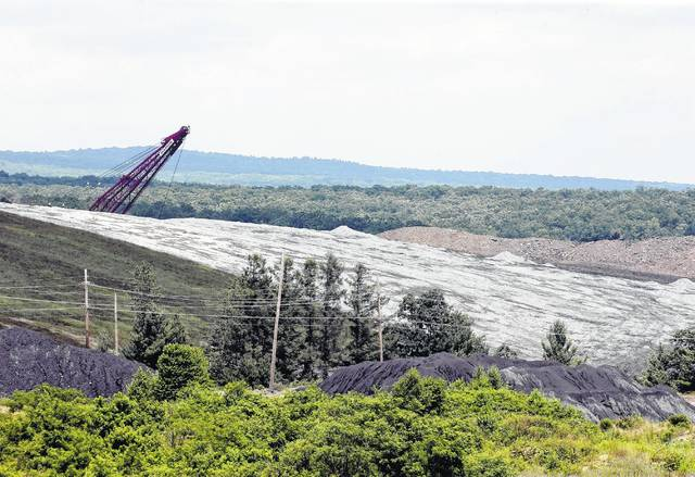 Mine land partially reclaimed with limestone sits in the shadow of a dragline excavator on State Game Land 75 in Lycoming County. (Bill Tarutis | For Times Leader)