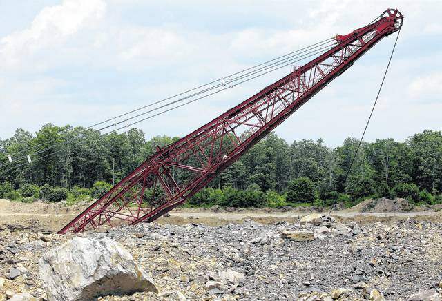 A dragline excavator works to remove material on a coal mine site operated by the Fisher Mining Company on State Game Land 75. (Bill Tarutis | For Times Leader)