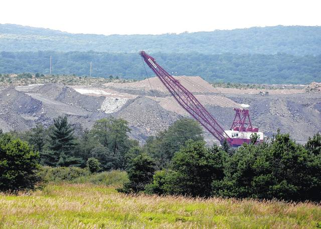 A dragline excavator works to move material beyond a previously reclaimed mine area by the Fisher Mining Company on SGL 75. (Bill Tarutis | For Times Leader)
