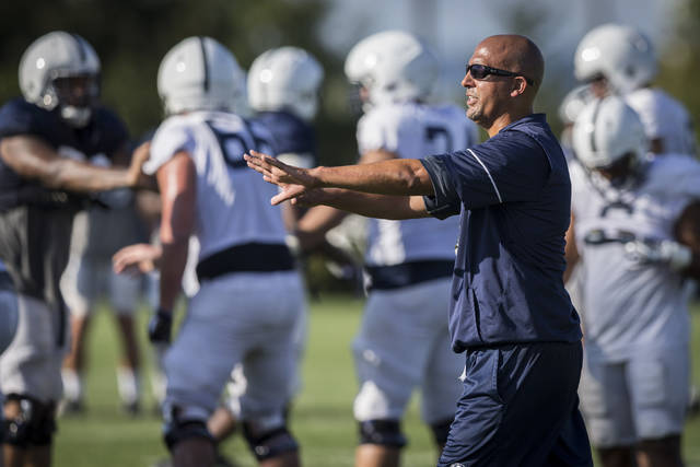 7fee690ce9ce0 Penn State coach James Franklin directs his team during NCAA college football  practice Wednesday
