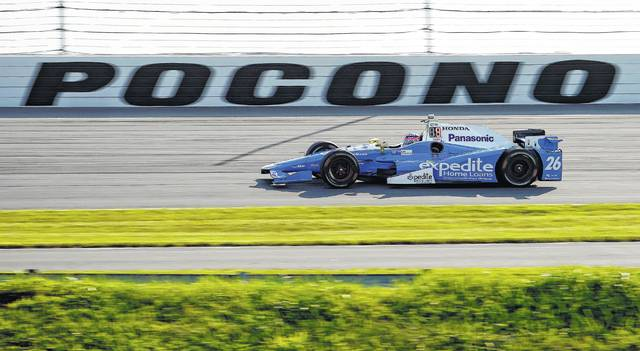Takuma Sato drives through Turn 3 during Saturday's practice in Long Pond.