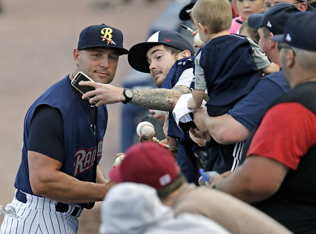 Yankees designated hitter Matt Holliday poses for a selfie with a fan while signing autographs before the game with Rochester at PNC Field in Moosic on Wednesday night. It was his second game with the RailRiders.