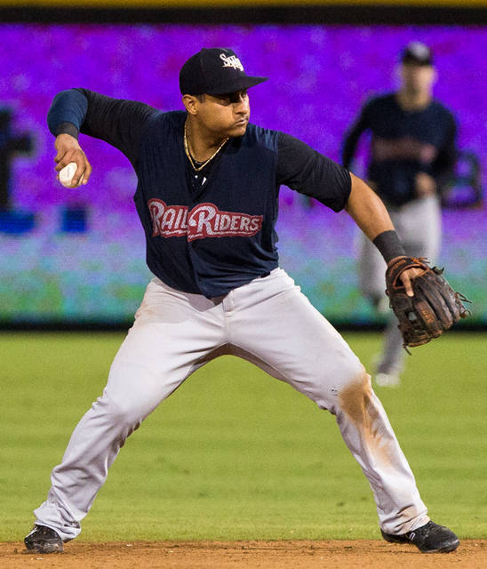 RailRiders second baseman Donovan Solano throws over to first.