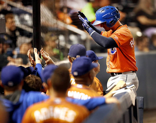 Durham Bulls third baseman Daniel Robertson is congratulated as he enters the dugout after hitting a home run in the sixth inning against Scranton/Wilkes-Barre in the Governors' Cup Finals Friday at PNC Field in Moosic.