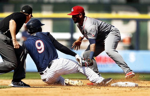Scranton/Wilkes-Barre RailRiders third baseman Miguel Andujar is tagged out at second base by Lehigh Valley shortstop Angelo Mora during the fourth inning.
