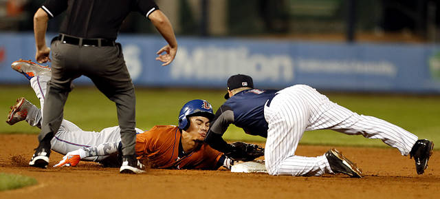 Durham Bulls' Willy Adames dives back to second base, just beating the tag by Scranton/Wilkes-Barre RailRiders shortstop Jonathan Diaz in the fifth inning of the Governors' Cup Finals.