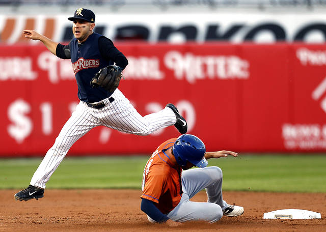 Scranton /Wilkes-Barre RailRiders shortstop Jonathan Diaz jumps to avoid Durham's Patrick Leonard sliding into second base as he watches the out at first base on a double play in the second inning Friday at PNC Field in Moosic.