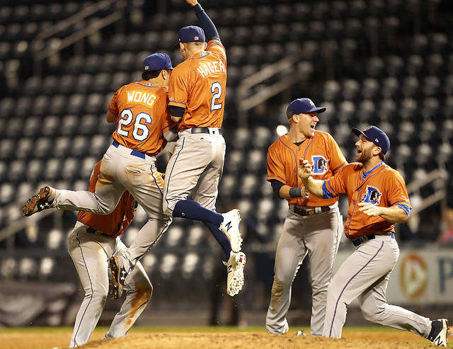 The Durham Bulls celebrate winning the Governors' Cup Finals with a 6-4 victory over the Scranton/Wilkes-Barre RailRiders in Game 4 on Friday at PNC Field.