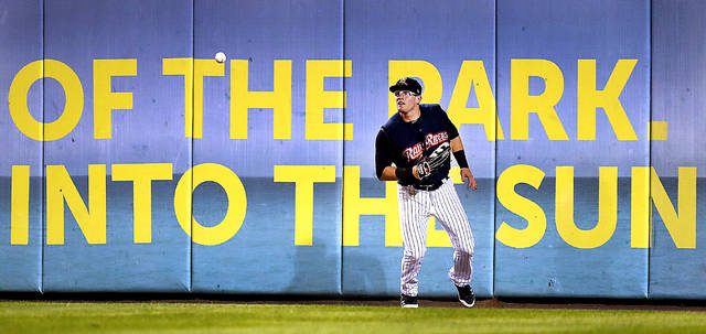 Scranton/Wilkes-Barre RailRiders right fielder Billy McKinney eyes up a bouncing ball hit by Durham batter Willy Adames in the fourth inning Friday during Game 4 of the Governors' Cup Finals.