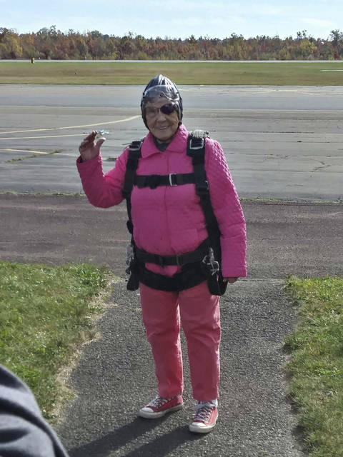 This Sunday, Oct. 22, 2017, photo provided by Eric Fox shows Eila Campbell, of Williamsport, Pa., waving as she celebrates her 94th birthday by going skydiving with her granddaughter and great-granddaughter at Above the Poconos Skydivers at Hazleton Regional Airport in Hazleton, Pa. (Eric Fox via AP)