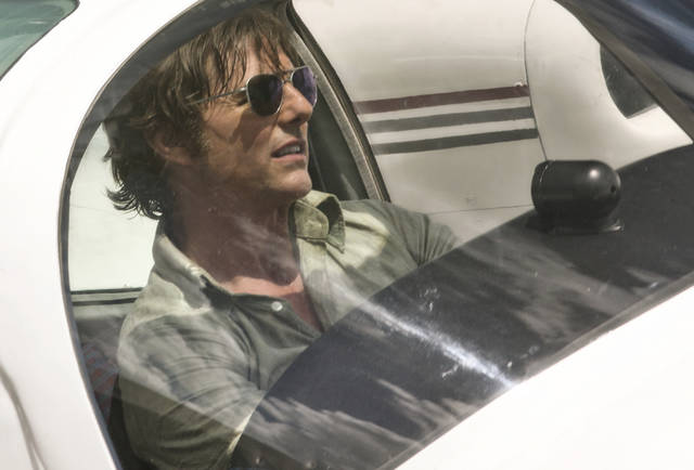 Tom Cruise stars as a 1980s-era pilot recruited to smuggle weapons and drugs by the CIA in 'American Made.'