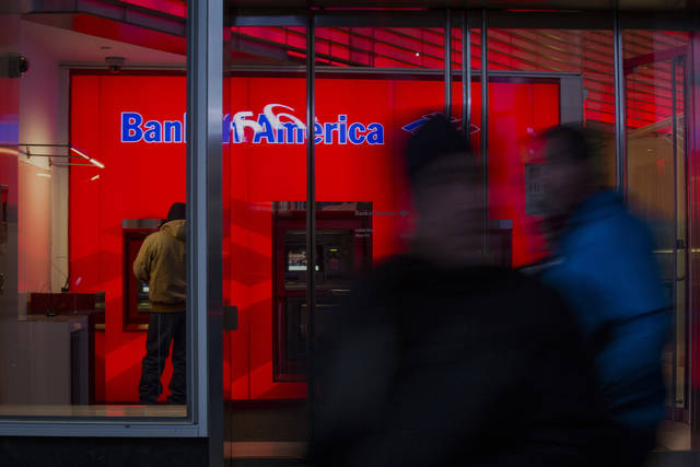 A customer uses an automated teller machine inside of the Bank of America Financial Center in Manhattan last January. (John Taggart/Bloomberg)