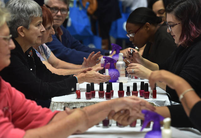 Alysia Alaishuski, left, has her nails manicured and painted by Lindsey Betancourt of Jolie Health and Beauty at the senior expo held at the 109th Field Artillery Armory in Kingston on Thursday morning.