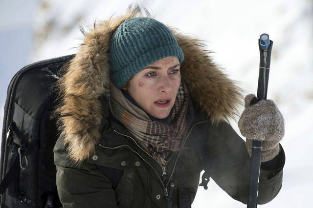 Kate Winslet plays a photojournalist who joins forces with a surgeon (Idris Elba) to survive after a plane crash in 'The Mountain Between Us.'